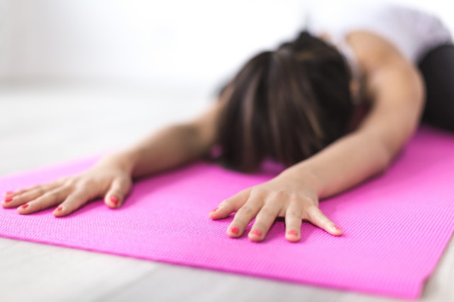 woman stretching as part of her self-care routine