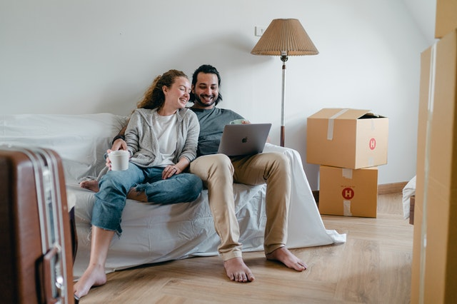 couple working from home when moving house
