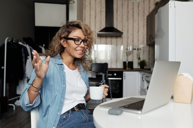 woman having virtual coffee working from home