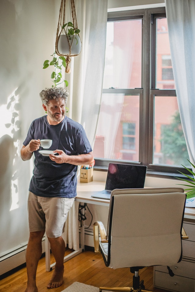 man working from home with tea