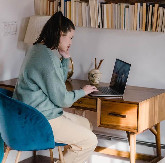 woman WFH at desk laptop